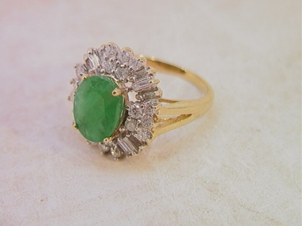 515: 14K Gold Emerald and Diamond Ring.  One Large oval