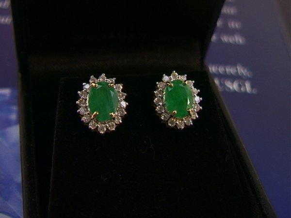 516: 14K Gold Emerald and Diamond Earrings. each earrin