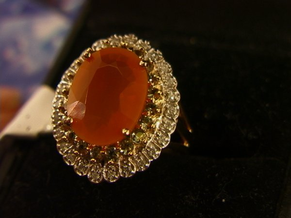 522: 14K Gold Fire Opal and diamond Ring.  4.20 ct oran