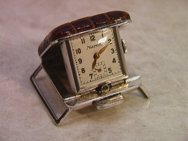 10: Micron Flip up Chrome and Leather Watch. No band.