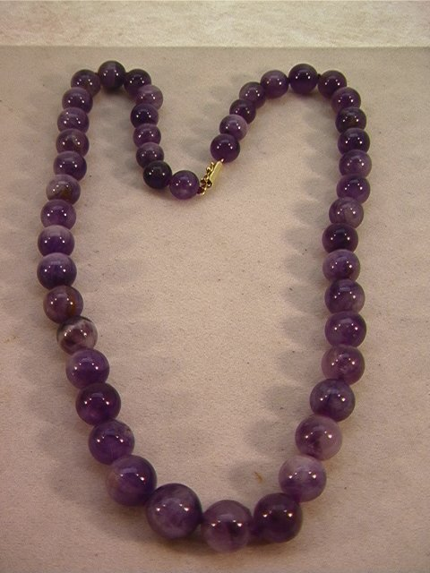 19: Large Amethyst Bead Necklace with 14K Gold Clasp.