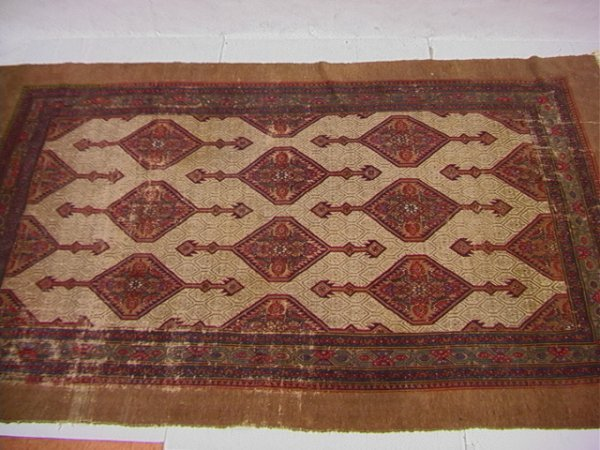 288: 7'2x12' Oriental carpet with tan border and repeat