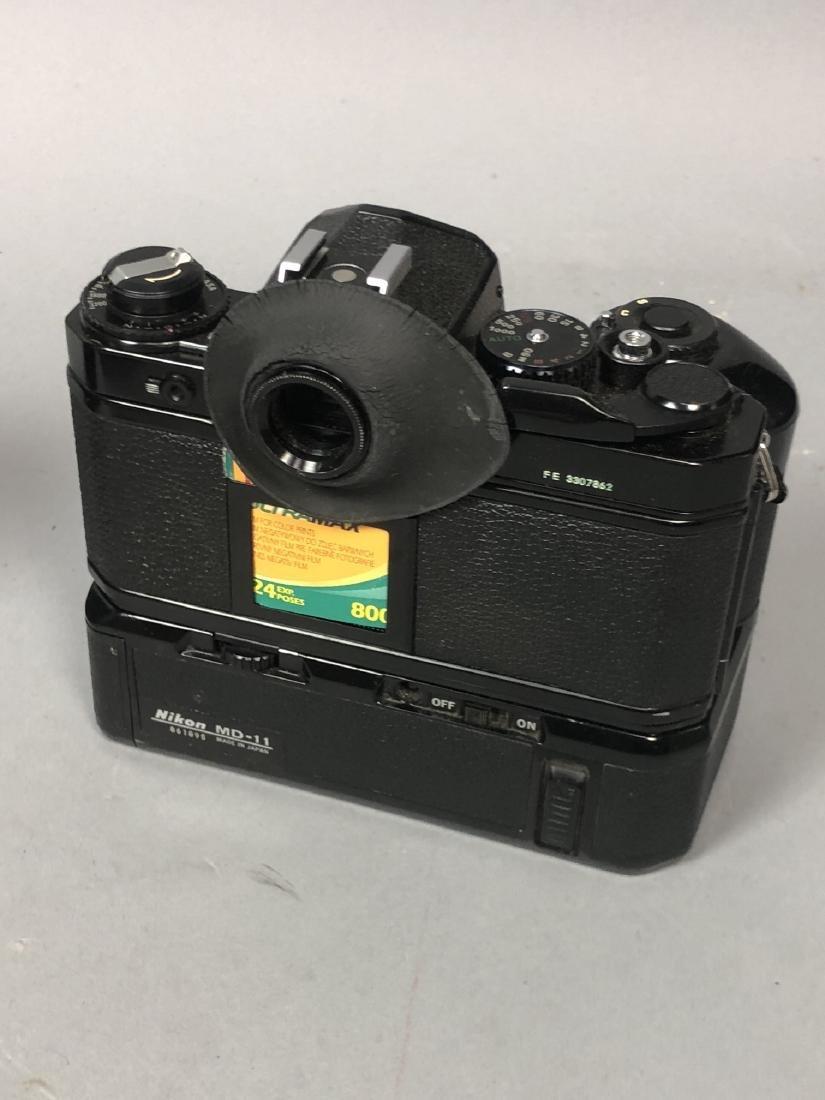 3pc NIKON 35mm Vintage Cameras. Lot includes FA, - 3