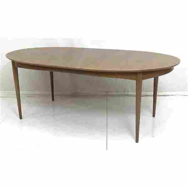 American Modern Walnut Banded Oval Dining Table.
