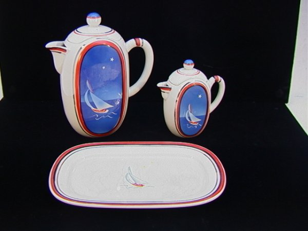 310: Art Deco Porcelain Coffee Set. Two Pots and a tray