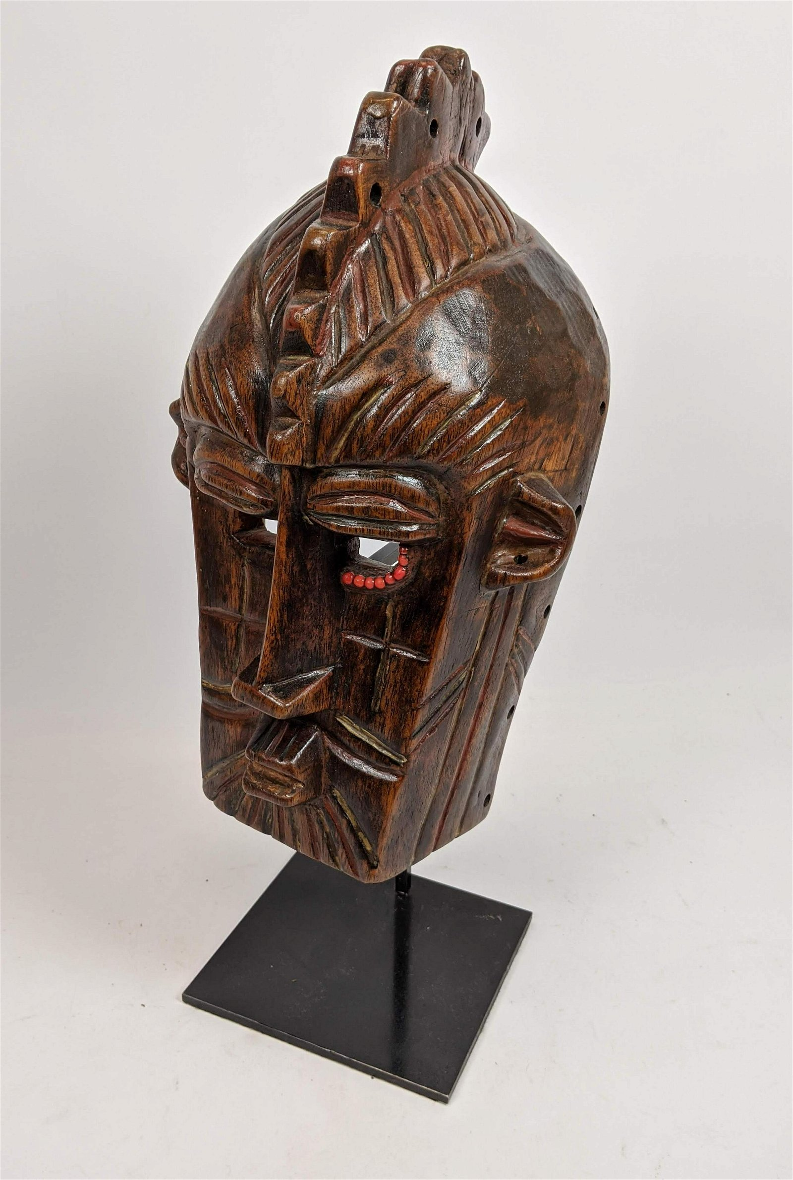 Carved Wood Tribal Face Mask. Custom stand supporting l