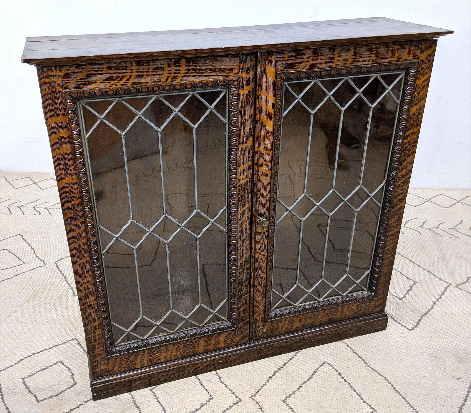 Tiger Oak Bookcase with Leaded Glass Doors.