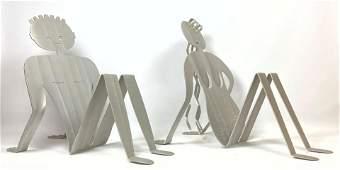 Pair Cut Aluminum Figural Magazine Racks. ROCKLEDGE DES