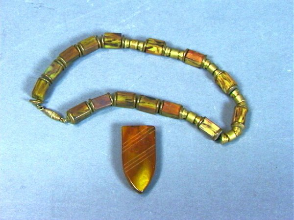 16: Marbled Bakelite Bead Necklace and Dress Clip.  B