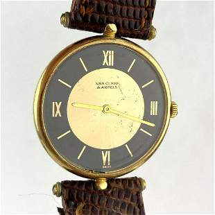 VAN CLEEF & ARPELS 14K Gold Wrist Watch. Leather band.