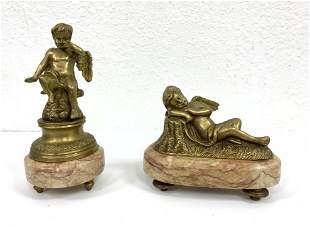 Pr Bronze Figural Winged Cherub Sculptures. Mounted on