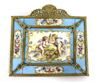 Ornate gilt metal frame with hand-painted porcelain til