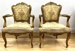 Pair Louis XV Style Gilt Carved Arm Chairs.  French sty