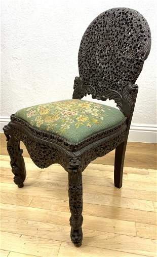 Antique East Indian Carved Rosewood Chair. Open heavily