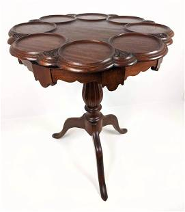 Mahogany Revolving Tea Table with Scalloped top. Carved