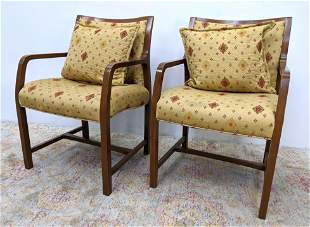 Pair Arm chairs. Upholstered with wood frames.