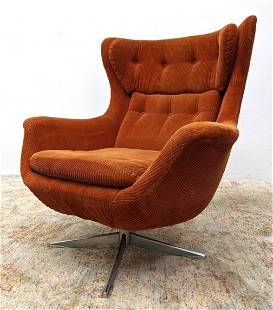 Modernist Tall Back Lounge Chair. Chrome swivel base wi