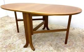 Danish Modern Teak Drop Side Dining Table. Oval drop si
