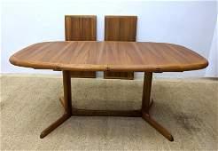 ANSAGER Teak Danish Modern Dining Table. Banded top on