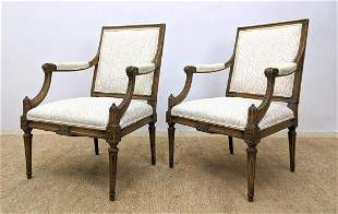 Pr Upholstered Fauteuils Arm Chairs. Carved frames with