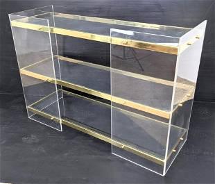 Three Tier Lucite Shelf Display Unit. Gold Tone band tr