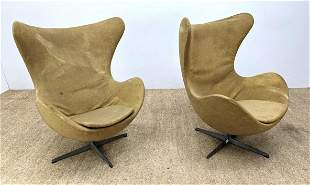 Pr FRITZ HANSEN Iconic Egg Lounge Chairs. Upholstered f