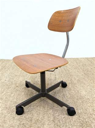 KEVI Office Desk Chair. Rolls on Casters