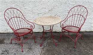 Red Metal Spring Seat Patio Chairs. Matching small tabl