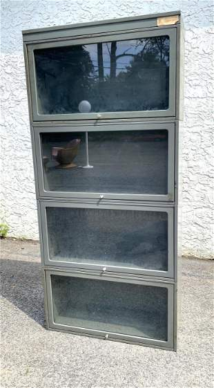 4 Part Metal Stacking Bookcase. One larger section. JEB