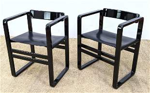 Pair Italian Black Lacquer Arm Chairs. Sling seat.