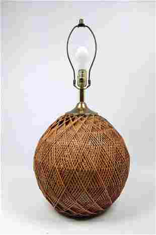 Intricate Woven Rattan Table Lamp. Bulbous form.