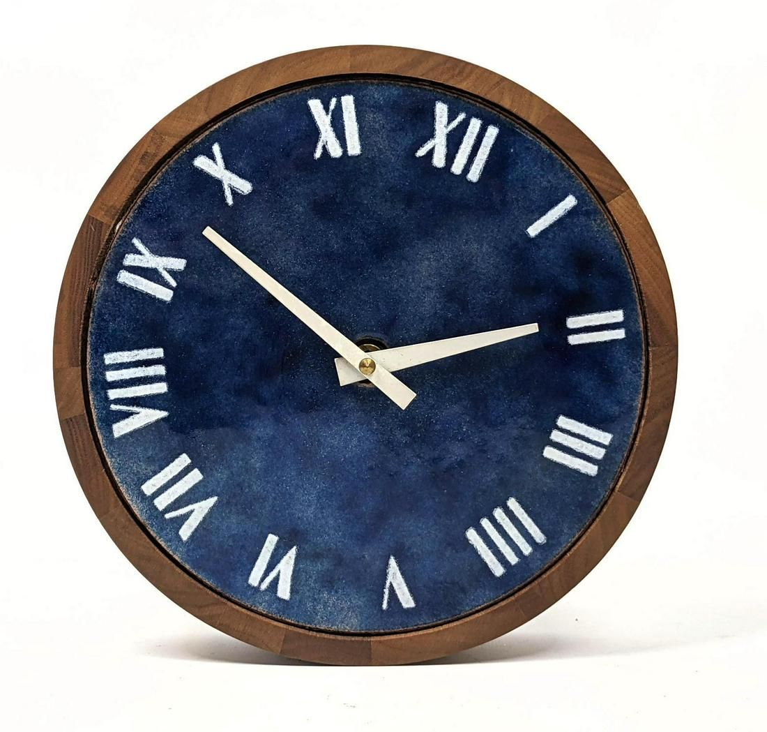 Mid Century Modern Enamel and Teak Wall Clock.