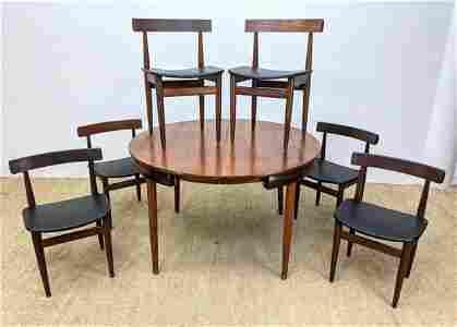 FREM ROJLE 7pc Teak Modern Dining Set. Round Teak Table