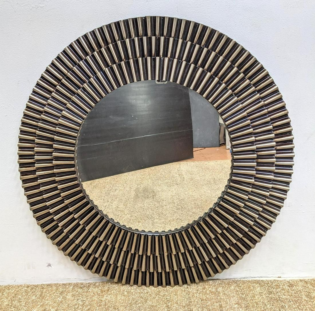 Contemporary Round wall Mirror with Wavy Metal Frame.