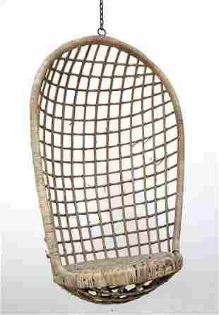 Worn Rattan Wicker Hanging Egg Chair.