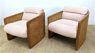 Pair Cane Side Lounge Chairs. Curved sides,