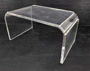 Thick Lucite Table with Decorative Ends.