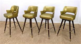 Set 4 Gold Vinyl Modernist Swivel Bar Stools. Wood legs
