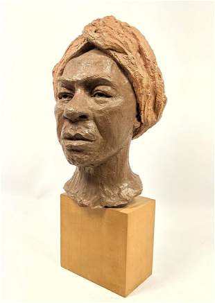 Pottery Bust Sculpture on Wood Base.