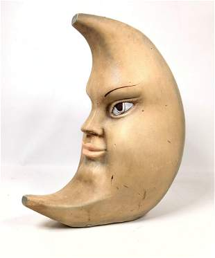 Crescent moon sculpture with face. Whole thru where pro