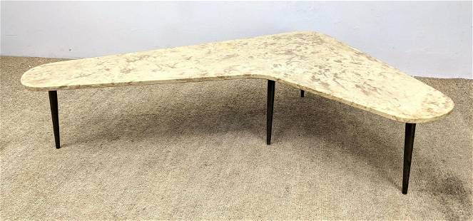 Italian Style Boomerang Table. Composite top with brass