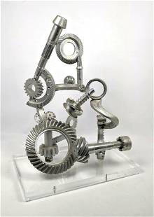 Industrial Gear Sculpture on Lucite Base.