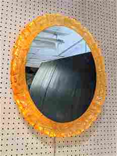 Oval Wall Mirror with Acrylic Frame. Lights from behin