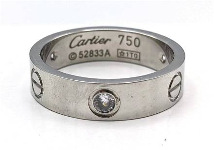 18k and Diamond Band Ring. Marked Cartier. Ring as fo