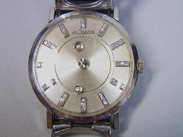 3: 14K Gold and Diamond LeCoultre Mystery Watch.