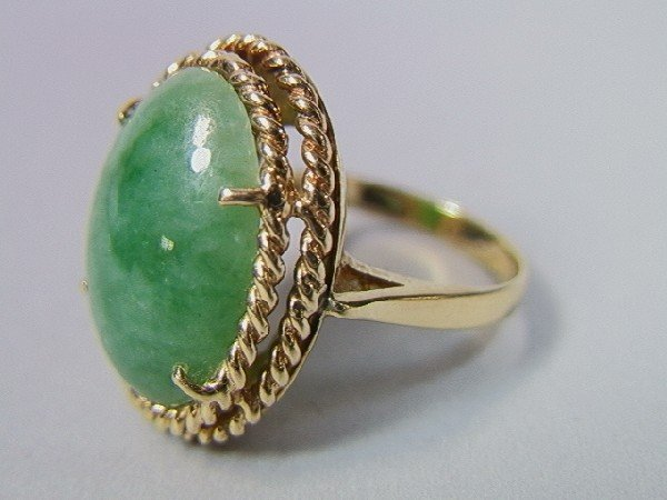 10: 14K Gold and Jade Ring.  Large oval jade stone.
