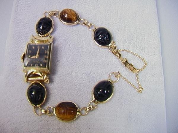 12: 14K Gold and Scarab Hamilton Ladies Watch.  Onyx