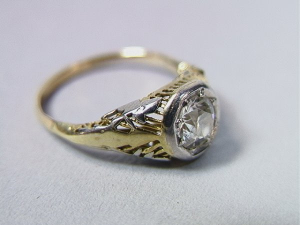 19: Diamond Solitaire Ring.  Approx.  .60C.  Gold set
