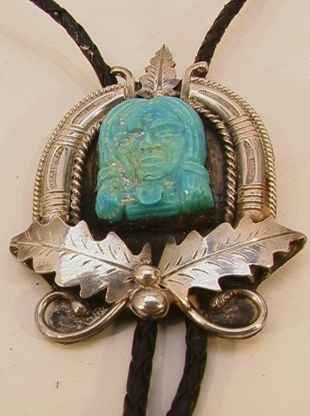 18: Native American Indian Carved Turquoise Bolo. Silve