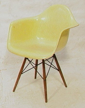 105: Early Eames Herman Miller Dowel Leg Shell Chair.